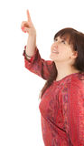 Smiling fat young woman in red dress pointing up Stock Image