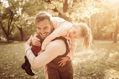 Smiling father in autumn day with daughter. Smiling young father in autumn day with daughter stock photography