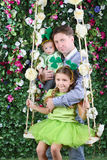 Smiling father with baby and little girl with shamrock on head Royalty Free Stock Images
