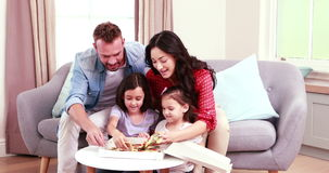 Smiling father bringing pizza for family stock footage