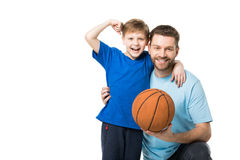 Smiling father and child ready to play basketball. Boy showing his biceps. Isolated on white Royalty Free Stock Images