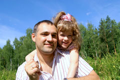 Smiling father and the daughter. Portrait happy men and girls in the summer in park Royalty Free Stock Photo