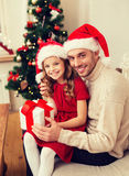 Smiling father and daughter holding gift box Stock Photography