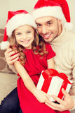 Smiling father and daughter holding gift box Stock Image
