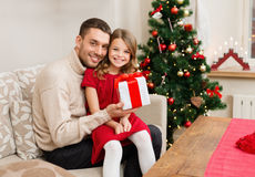 Smiling father and daughter holding gift box Royalty Free Stock Images