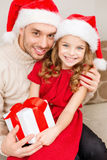 Smiling father and daughter holding gift box Stock Images