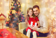 Smiling father and daughter holding gift box Royalty Free Stock Photo