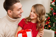 Smiling father and daughter looking at each other. Family, christmas, x-mas, winter, happiness and people concept - smiling father and daughter holding gift box Stock Photography