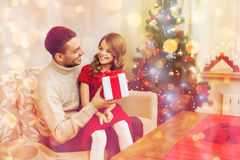 Smiling father and daughter looking at each other. Family, christmas, x-mas, winter, happiness and people concept - smiling father and daughter holding gift box Stock Image