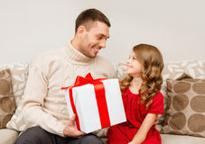 Smiling father and daughter looking at each other Stock Images