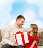 Smiling father and daughter looking at each other Royalty Free Stock Images
