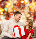 Smiling father and daughter looking at each other Royalty Free Stock Photos