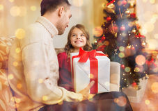 Smiling father and daughter looking at each other Stock Photos