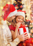 Smiling father and daughter opening gift box Royalty Free Stock Photo