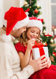 Smiling father and daughter opening gift box Royalty Free Stock Photography