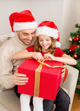 Smiling father and daughter opening gift box Stock Image