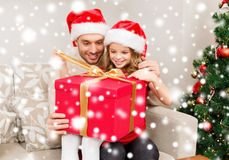 Smiling father and daughter opening gift box Stock Photo