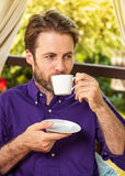 Close up portrait of forty years old caucasian man drinking morning coffee outdoor Royalty Free Stock Photography