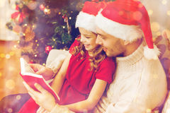 Smiling father and daughter reading book Royalty Free Stock Image