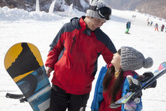 Smiling Father and Daughter in Ski Resort Stock Images