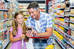 Smiling father and daughter at the supermarket Stock Photo