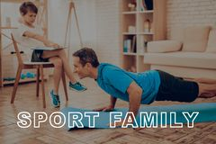Smiling Father Is Doing Push Ups. Sport Family. Healthy Lifestyle. Active Holiday. Exercises Clothes. Getting Better. Working Out At Home. Gym Carpet. Repeat Royalty Free Stock Photos