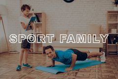 Smiling Father Is Doing Push Ups. Sport Family. Healthy Lifestyle. Active Holiday. Exercises Clothes. Getting Better. Working Out At Home. Gym Carpet. Repeat Royalty Free Stock Images