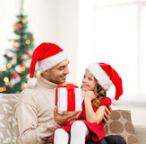 Smiling father giving daughter gift box Royalty Free Stock Images