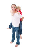 Smiling father giving his son piggyback ride Stock Images