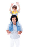 Smiling father giving piggyback ride to his boy. Smiling father giving piggyback ride to his little boy isolated on a white background Royalty Free Stock Image