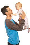 Smiling father with his baby daughter Stock Photos