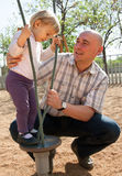 Smiling father and his little daughter playing royalty free stock photography