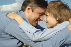 Smiling father and his son Stock Photography