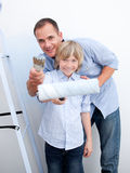 Smiling father and his son holding paintbrush Stock Photography