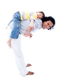 Smiling father and his son playing together. Isolated on a white background royalty free stock images