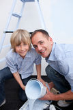 Smiling father and his son preparing paint Stock Photos