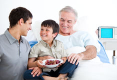 Smiling father and his son visiting grandfather Royalty Free Stock Photos