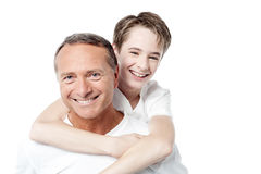 Smiling father holding son on his shoulders. Happy father and son on a white background Royalty Free Stock Photography