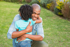 Smiling father hugging his daughter Stock Photo