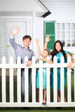 Smiling father, mother and little daughter wave their hands Royalty Free Stock Photos