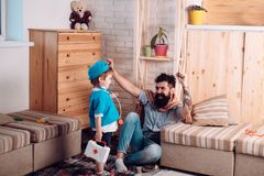 Smiling father playing with cute little son in hospital, dad and son in hospital.  stock image