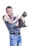 Smiling father with son. Smiling father is holding his son on the hands isolated on white Stock Photography