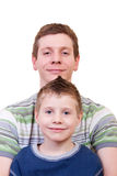 Smiling father and son. In studio on white background Stock Photo