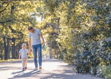 Smiling father and son with a skateboard stock images
