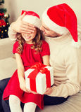 Smiling father surprises daughter with gift box Stock Image