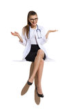 Smiling Feamle Doctor Sitting On A Top Of Banner Stock Images