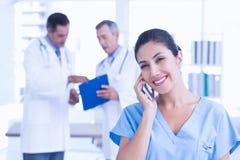Smiling femal doctor phoning Stock Photos