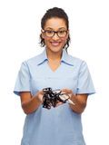 Smiling female african-american doctor or nurse Stock Photo
