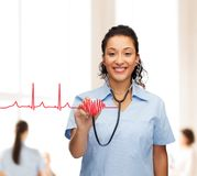 Smiling female african american doctor or nurse Stock Photo