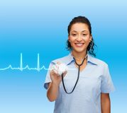 Smiling female african american doctor or nurse Stock Photos